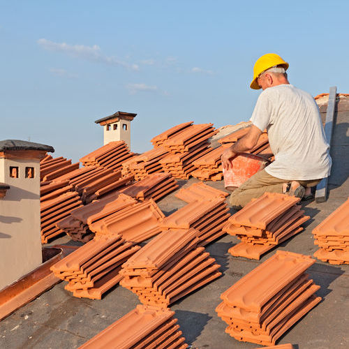 Roofer Installing Roof Tiles.