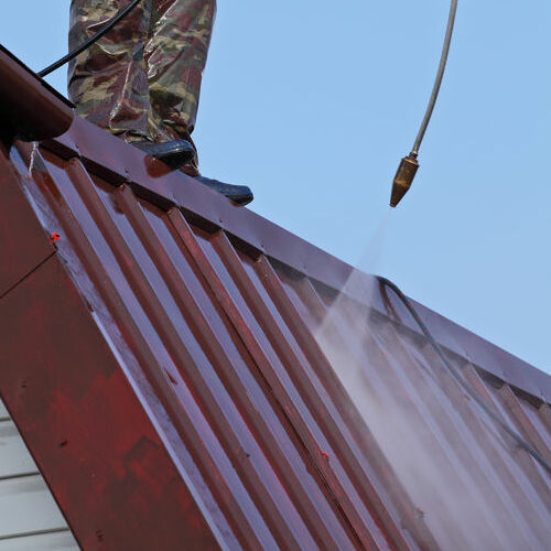 Roofers Clean a Roof Before Adding a Roof Coating.