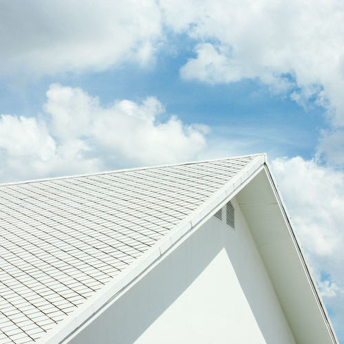 Cool roofing systems save energy bills by reflecting heat away from the building.