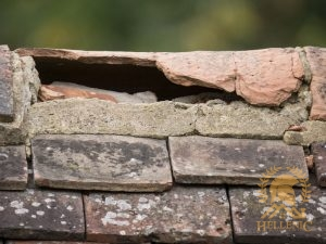 Severely Damaged Ridge Tile and Exposed Roofing
