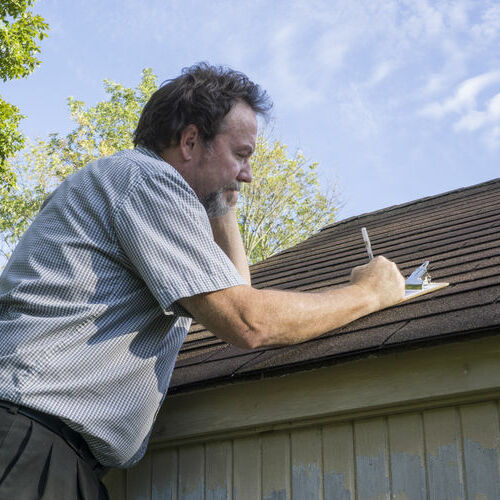 contractor working on roof inspection